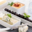 Appetizers blue cheese and black marinated olives — Stock Photo
