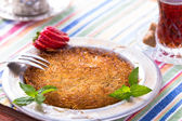 Kunefe, Turkish Dessert with hot tea — Stock Photo