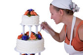 Final Retouching Ruffled Wedding Cake — Stock Photo