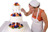 Final Touch ups on Ruffled Wedding Cake — Stock Photo