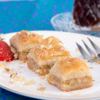Baklava Garnished with Strawberry and Walnuts — Stock Photo