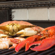 Barbecuing Red Lobster, Crab and Jumbo Shrimps — Stock Photo