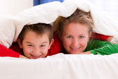Mother and Son Under Blanket Smiling Cheerfully — Stock Photo