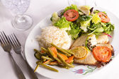 Tilapia Cooked with Capers Lemon and Tomatoes Served with Vegetables and Pilaf Rice — Stock Photo