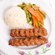 Adana Kebabs Served on a Lavash Bread Garnished with Vegetables — Stock fotografie