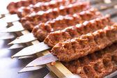 Seasoned Adana Kebabs on Skewers Waiting to be Cooked — Stock Photo