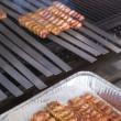 Cooking Adana Lamb Kebabs on the Restaurant Style Grill — Stock Photo