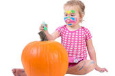 Toddler Girl Painting the Pumpkin for Halloween — Stock Photo