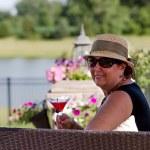 Senior Woman Having Martini Outdoors — Stock Photo #35512007