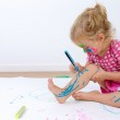 Cute Toddler Painting Her Legs Carefully — Stock Photo #35734249
