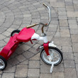 Childs Red Tricycle Parked — Stock Photo