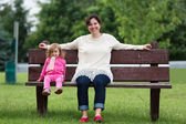 Mother and Her Daughter having Fun Outside on the Bench — Stock Photo
