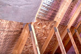 Gable View of Ongoing House Attic insulation Project with Heat a — Stock Photo