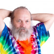 Senior Man With his Tie Dye T-Shirt Holding his Hair on the back — Stock Photo