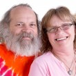 Genuinly Happy Baby Boomer Couple Looking at you Smiling — Stock Photo #36136521