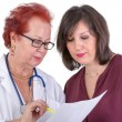 Female Doctor Discussing Ressults with Female Patient — Stock Photo #36517763