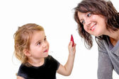 Cute little girl wants to apply her mothers makeup — Stock Photo