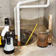 Stock Photo: Replacing old sump pump in basement