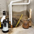Replacing the old sump pump in a basement — Stock Photo #37701301