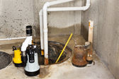 Replacing the old sump pump in a basement — Stock Photo