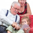 Grandparents babysitting their granddaughter — Stock Photo #37786389
