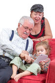 Grandparents babysitting their granddaughter — Stock Photo