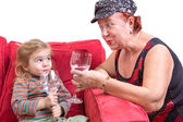Mischievous grandmother and granddaughter — Stock Photo