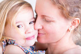Loving mother kissing her little daughter — Stock Photo
