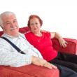 Attractive elderly couple smiling in satisfaction — Stock Photo #38002055