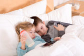 Tired little brother and sister going to sleep — Stock Photo
