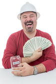 Construction worker laughing with vacations money — Stock Photo
