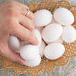 Stock Photo: Man taking an egg from an Easter basket
