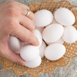 Man taking an egg from an Easter basket — Stock Photo