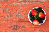 Bowl of fresh ripe mixed berries — Stock Photo