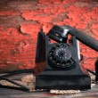 Old-fashioned rotary telephone off the hook — Stock Photo