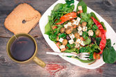 Dish of baby spinach salad with bread and tea — Stock Photo