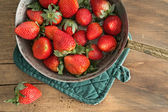 Bowl of freshly harvested ripe red strawberries — Stock Photo