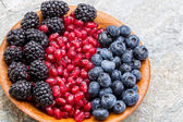 Fresh blueberries, blackberries and pomegranate — Stock Photo