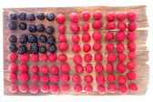 Unusual background USA Flag pattern of fresh berries — Stock Photo