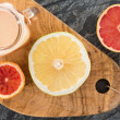 Постер, плакат: Freshly prepared grapefruit juice