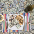 Eating money through greed and extravagance — Стоковое фото