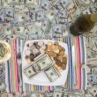 Stock Photo: Eating money through greed and extravagance