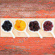 Assorted dried berries and fruit in ramekins — Foto Stock