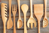 Set of rustic wooden handcrafted kitchen utensils — Stock Photo