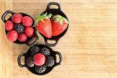 Ramekins of healthy ripe fresh mixed berries — Stock Photo