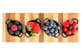 Ripe fresh autumn berries in separate dishes — Stock Photo