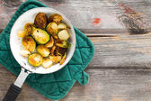 Sauteed brussels sprouts in a saucepan — Stock Photo