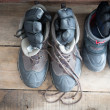 Stock Photo: Adult snow boots alongside those of child