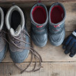 Stock Photo: Adult and kids snow boots with gloves
