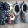 Stock Photo: Snow boots and bag of winter gloves and mittens